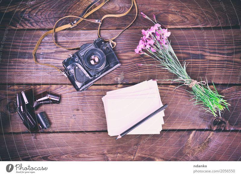 Blank greeting card and old vintage film camera Vacation & Travel Camera Flower Bouquet Wood Old Brown Pink Pencil background Dianthus caryophyllus Top