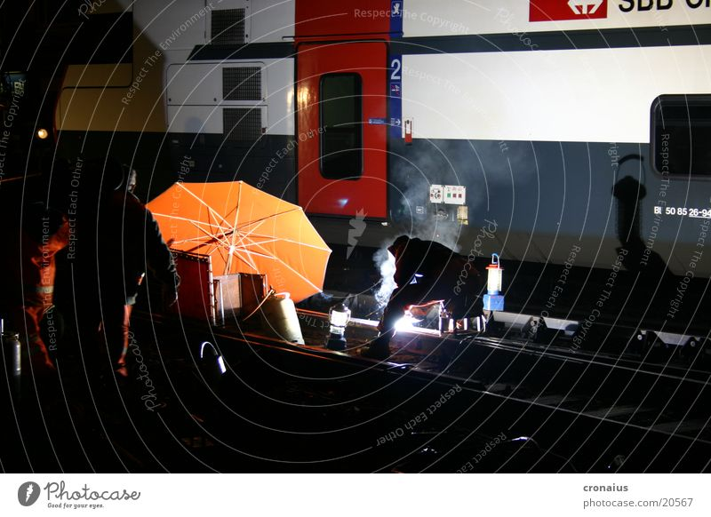 welding work 1 Night Railroad tracks Gas burner Electrical equipment Technology Umbrella Orange sbb Electricity