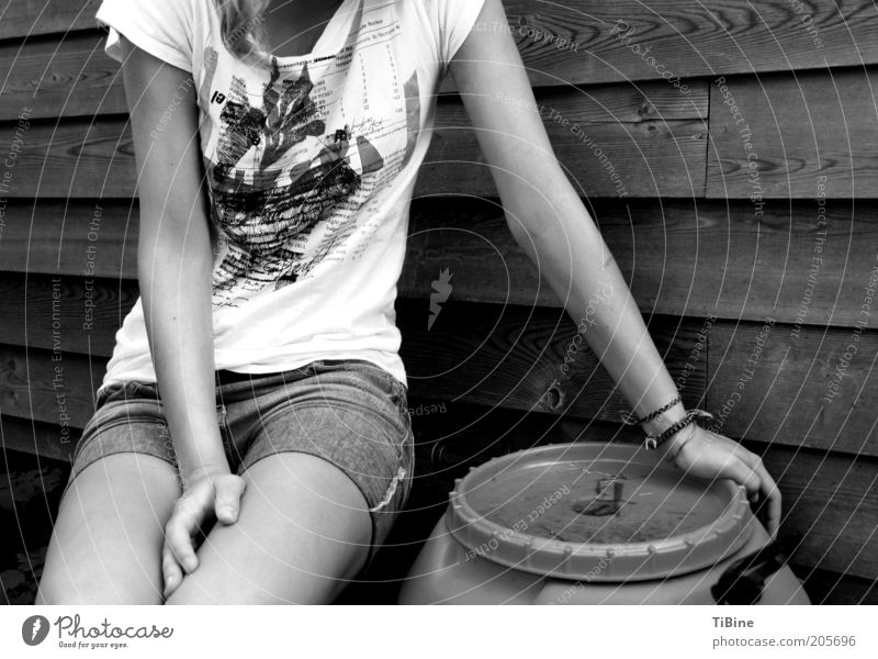 Milena Human being Feminine Young woman Youth (Young adults) Arm Legs 1 T-shirt Jeans Sit Calm Relaxation Black & white photo Exterior shot Evening Contrast