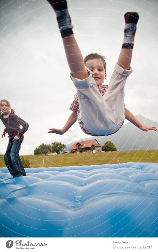 Human being Child Blue Girl Joy Landscape Boy (child) Freedom Movement Happy Jump Infancy Crazy Happiness Authentic