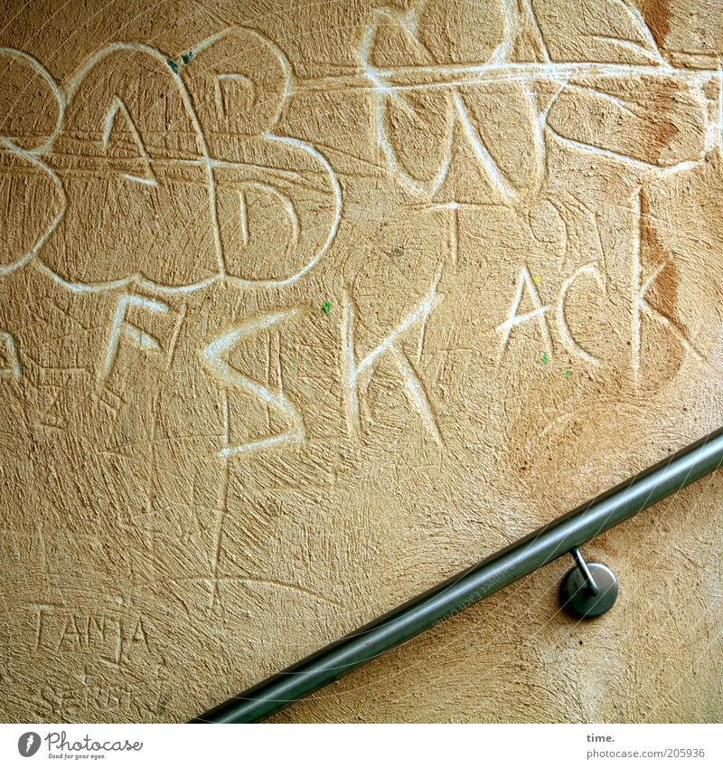 Wall (building) Wall (barrier) Letters (alphabet) Word Typography Banister Plaster Beige Graphic Text Tagging (graffiti) Characters Scribbles Capital letter
