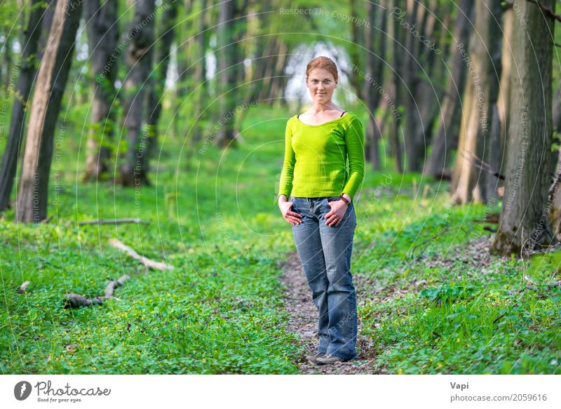Pretty young woman in green forest Human being Woman Nature Vacation & Travel Youth (Young adults) Plant Blue Young woman Summer Beautiful Green White Sun Tree