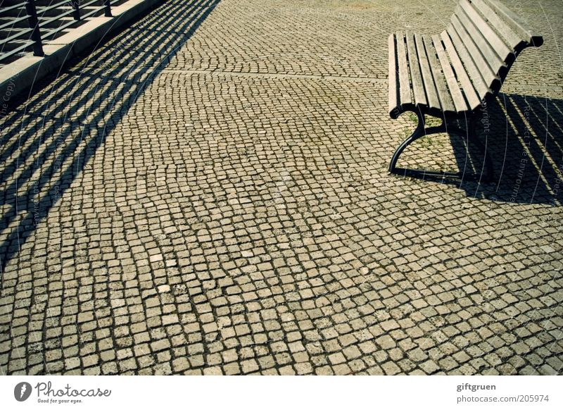 heat holiday Places Bench Seating Park bench Wooden bench Handrail Cobblestones Shadow play Building line Empty Summer Beautiful weather Free Pavement Furniture