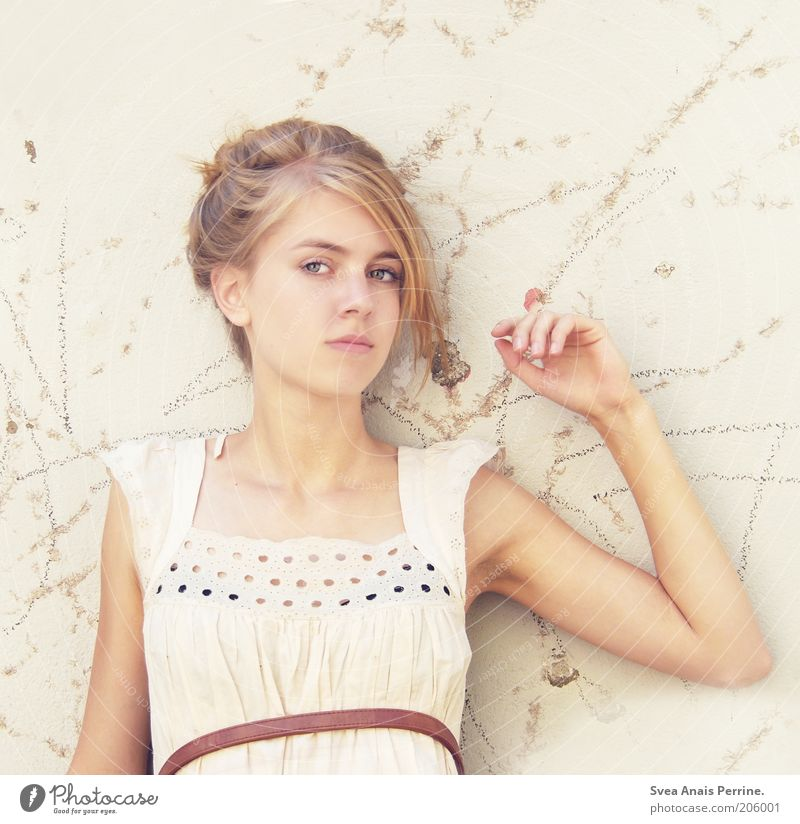 Human being Youth (Young adults) White Beautiful Face Feminine Wall (building) Hair and hairstyles Wall (barrier) Style Fashion Bright Blonde Facade Skin Elegant