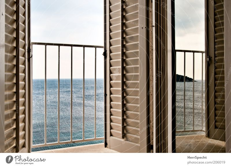 Room with sea view Sky Ocean Balcony Window Shutter Slat blinds Banister Blue Gray White Island Vantage point Calm Horizon Line Colour photo Subdued colour