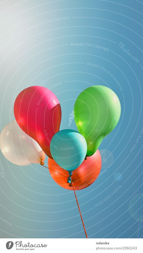 Multicolored balloons against the sky Sky Blue Summer Colour Green White Red Joy Happy Feasts & Celebrations Flying Bright Decoration Birthday Happiness