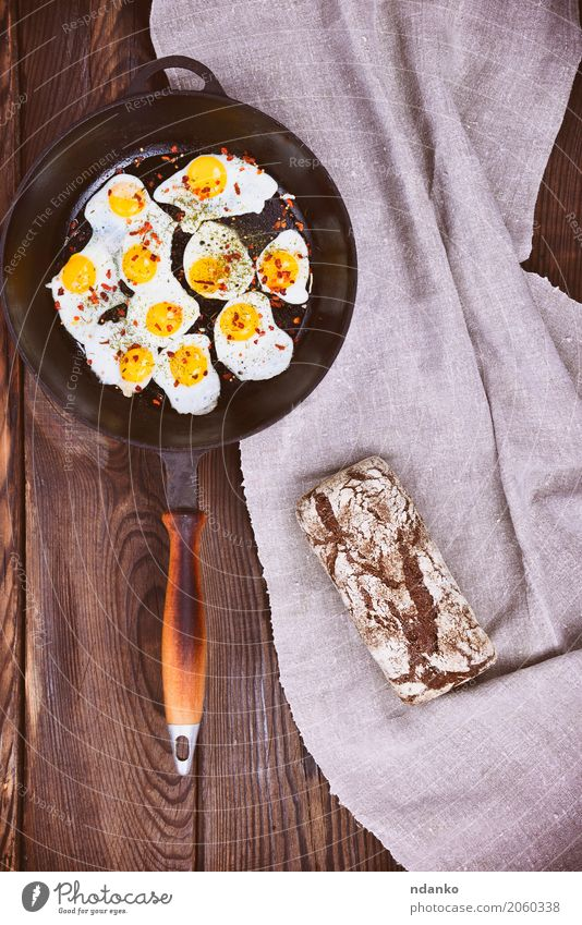 Fried quail eggs in a frying pan Dish Eating Yellow Natural Food Brown Above Retro Kitchen Breakfast Bread Meal Top Feed Rye Pan