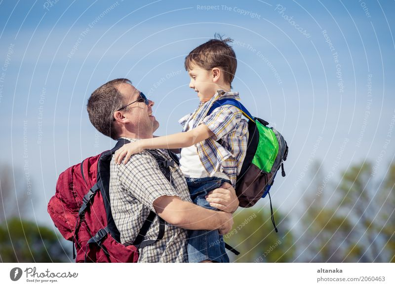 Father and son walking on the road at the day time. Human being Child Nature Vacation & Travel Man Summer Joy Adults Street Lifestyle Love Sports Boy (child)