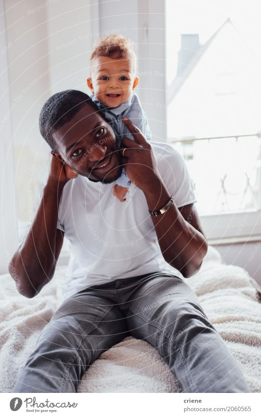 Portrait of African Father and toddler son Lifestyle Joy Living or residing Bedroom Masculine Baby Toddler Boy (child) Young man Youth (Young adults) Adults