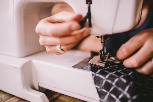 Close-up of woman sewing with sewing machine Lifestyle Handcrafts Work and employment Profession Workplace Services Business SME Career Sewing machine Feminine