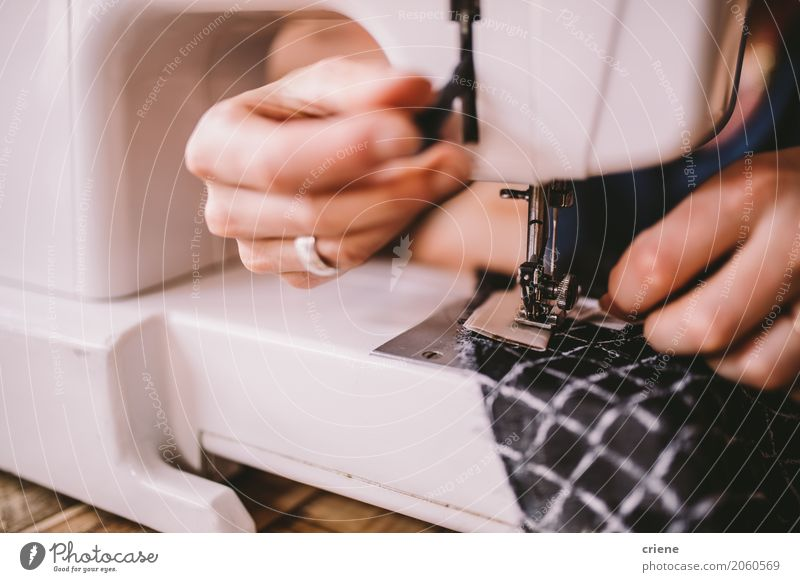 Closeup Of Woman Sewing With Sewing Machine A Royalty Free Stock Impressive Hands Free Sewing Machine