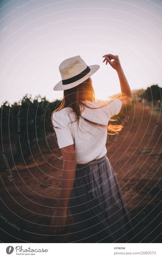 Young adult woman enjoying warm sunset on farmland Human being Woman Youth (Young adults) Summer Young woman Sun Landscape Relaxation Joy 18 - 30 years Adults