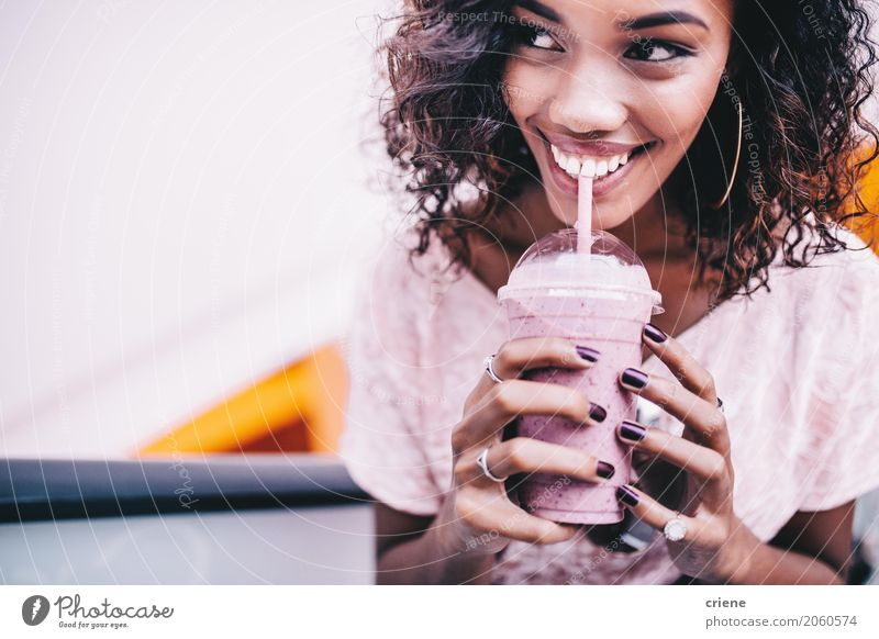 Happy Woman drinking a fresh strawberry smoothie Human being Youth (Young adults) Summer Young woman Beautiful Black Lifestyle Feminine Pink Fruit Fresh Stand