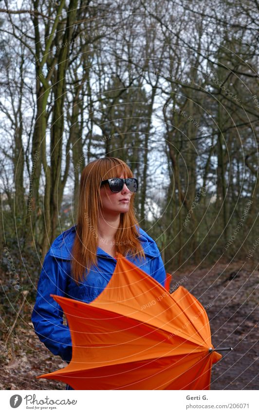 red haired handsome teenager, longhaired with black sunglasses, blue jacket, orange umbrella in the forest Woman Cool-headed Cautious Beautiful Sunglasses