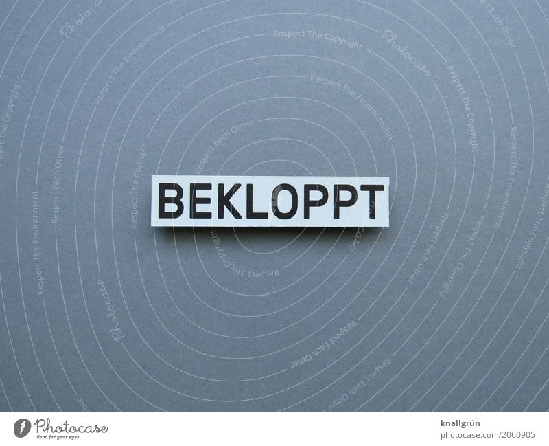 BECLOPPT Characters Signs and labeling Communicate Sharp-edged Gray Black White Emotions Moody Stupid Goofy Cuss word Derogative Rant Colour photo Studio shot