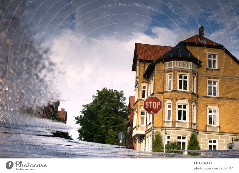 Puddle STOP Environment Luneburg Small Town Old town Building Architecture Transport Street Crossroads Road sign Bizarre Surrealism