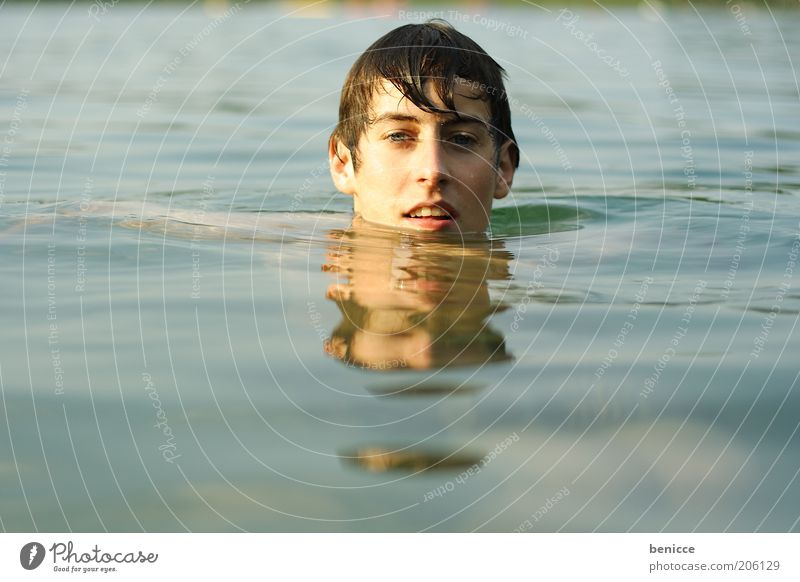 Human being Youth (Young adults) Water Ocean Blue Loneliness Boy (child) Lake Contentment Masculine Wet Teeth Swimming & Bathing Brunette