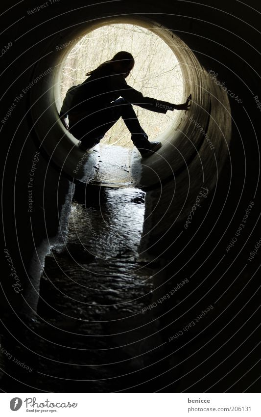 silhouette Silhouette Shadow Back-light Human being Woman Crouching Crouching position Sewer Channel Drainage system Water Brook Dark Round Hollow Cave Circle