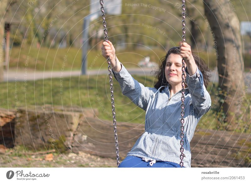 Having fun in life 2 - young brunette woman sitting with closed eyes enjoying on a swing in the park Human being Feminine Young woman Youth (Young adults) Woman