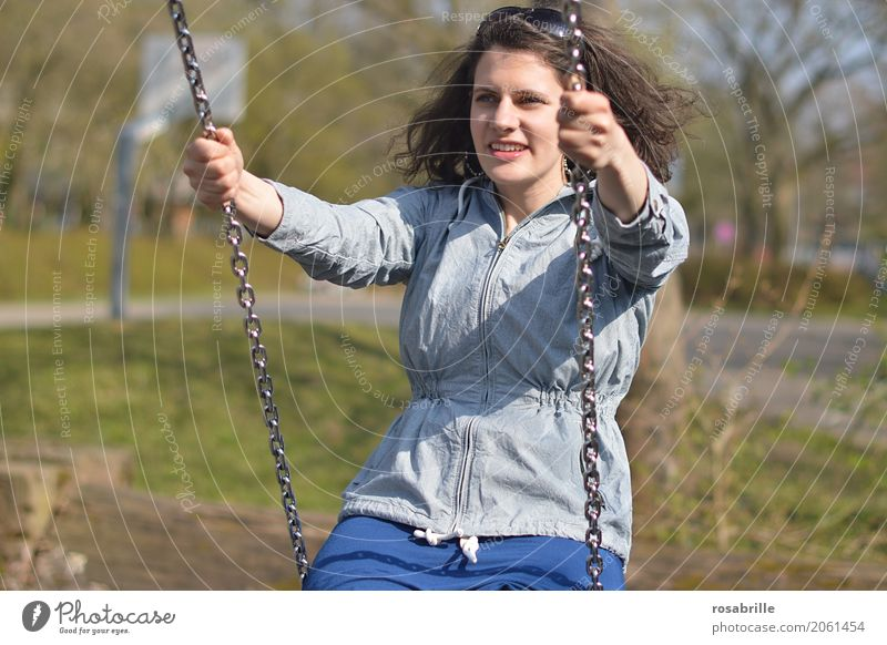 Having fun in life - young woman sitting on a swing in a park Human being Feminine Young woman Youth (Young adults) Woman Adults 1 18 - 30 years Jacket