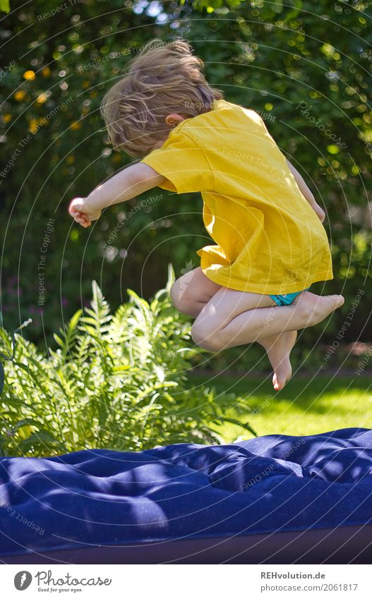 Human being Child Nature Green Joy Environment Yellow Meadow Sports Movement Boy (child) Playing Happy Garden Jump Contentment