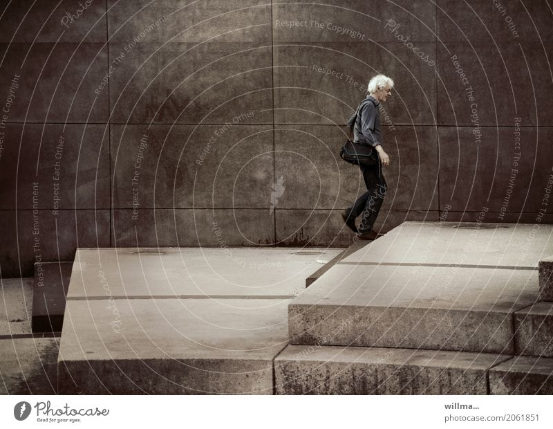 white-haired slim man walks over steps Man on one's own White-haired stagger Going Curl Bag Walking urban Gray climb the stairs Wall (building) Stairs Upward