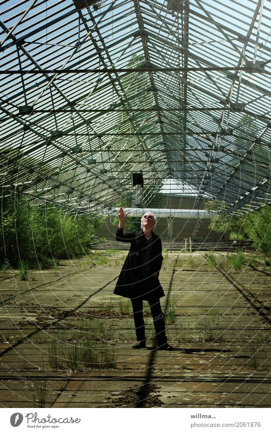 Man in frock coat throws top hat in the air Frock coat Cylinder Sunglasses Hat Greenhouse White-haired Throw bushes Full-length Front view Human being Masculine