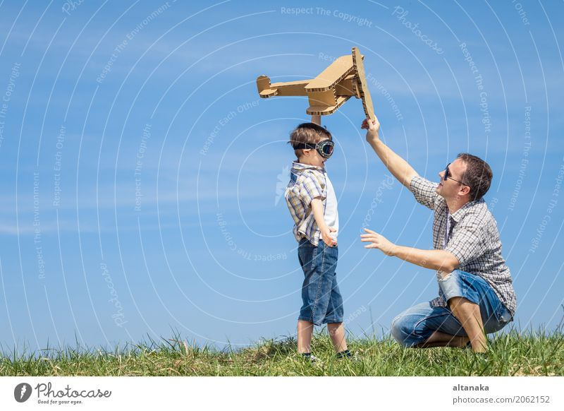 Father and son playing with cardboard toy airplane Human being Child Nature Vacation & Travel Man Summer Hand Joy Adults Life Lifestyle Love Sports Boy (child)