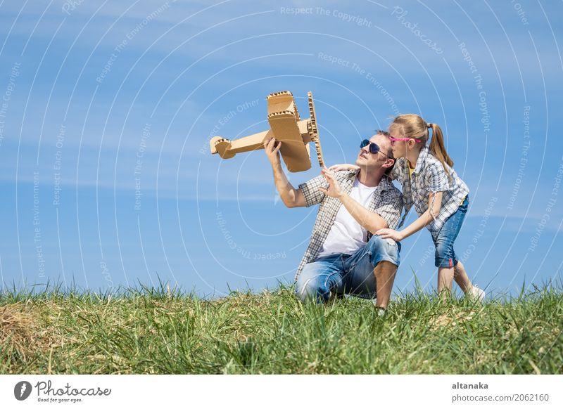 Father and daughter playing with cardboard toy airplane Human being Child Nature Vacation & Travel Man Summer Hand Joy Adults Life Lifestyle Love Sports