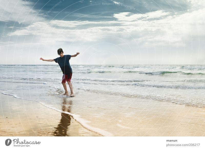Sky Nature Youth (Young adults) Water Vacation & Travel Ocean Beach Joy Clouds Relaxation Life Landscape Boy (child) Movement Happy Coast