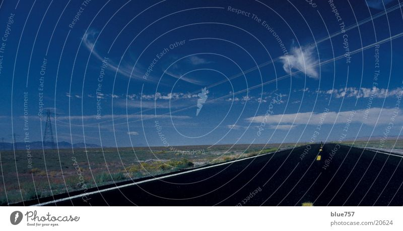 Sky White Blue Black Clouds Yellow Far-off places Street Cable Electricity pylon Electronic High voltage power line Median strip