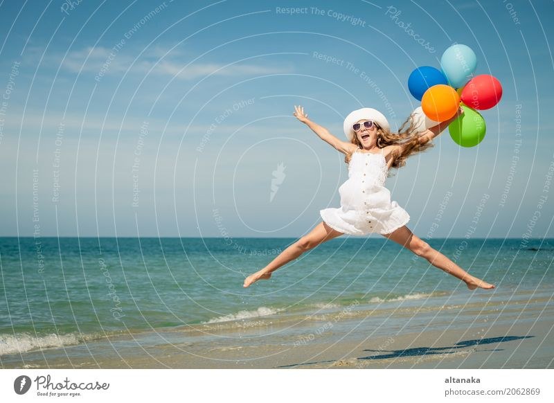 Teen girl with balloons jumping on the beach Human being Child Woman Nature Vacation & Travel Summer Sun Hand Ocean Relaxation Joy Beach Adults Lifestyle