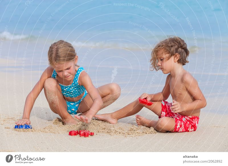 Two happy children playing on the beach Lifestyle Joy Happy Beautiful Relaxation Leisure and hobbies Playing Vacation & Travel Freedom Summer Sun Beach Ocean