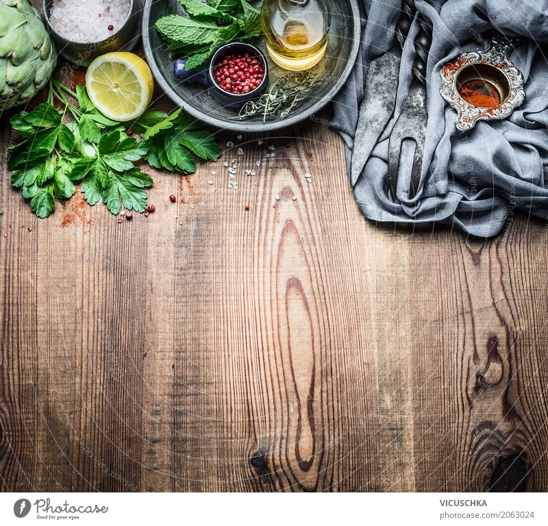 Fresh kitchen herbs and spices on a rustic kitchen table Food Herbs and spices Cooking oil Nutrition Organic produce Vegetarian diet Diet Crockery Style Design