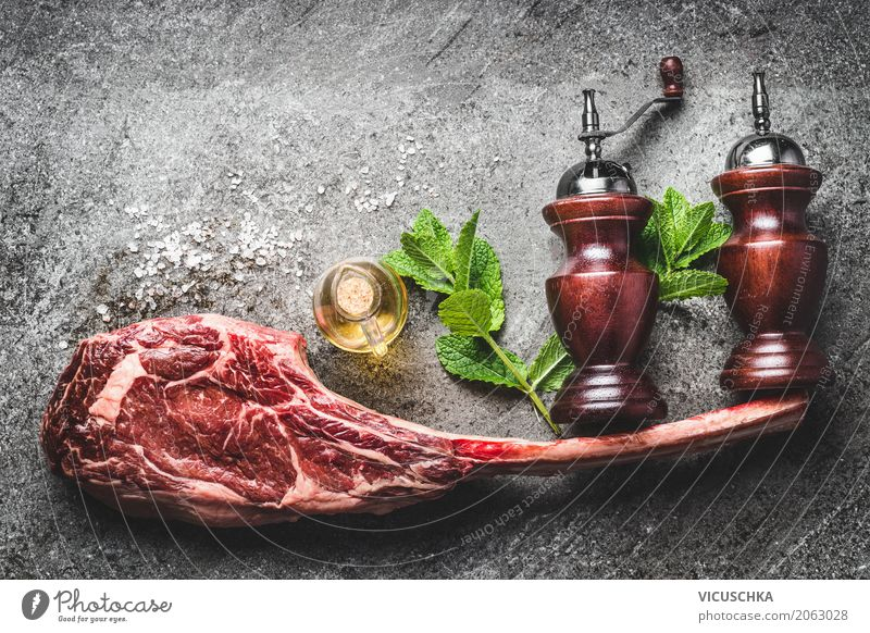 RoherTomahawk beef steak with spices, salt and pepper shaker Food Meat Herbs and spices Cooking oil Nutrition Dinner Business lunch Organic produce Style Design