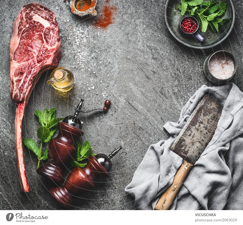 Tomahawk beef steak with knife, spices and fresh herbs Food Meat Herbs and spices Cooking oil Nutrition Lunch Organic produce Crockery Knives Style Design Table