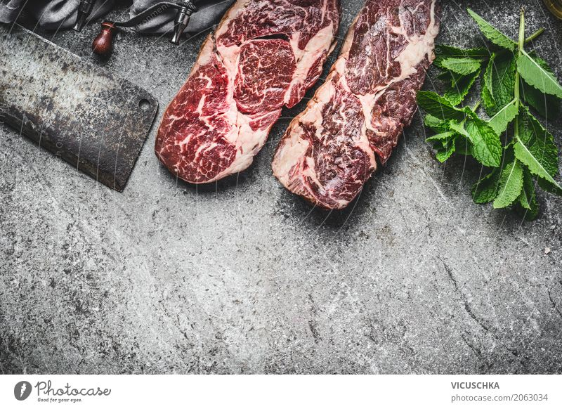 Steaks with meat knife and fresh kitchen herbs Food Meat Herbs and spices Nutrition Knives Style Design Table Kitchen Restaurant Barbecue (apparatus)