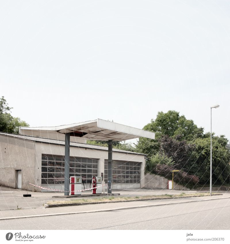 petrol station Sky Plant Tree Bushes Manmade structures Building Architecture Petrol station Traffic infrastructure Street Gloomy Colour photo Exterior shot