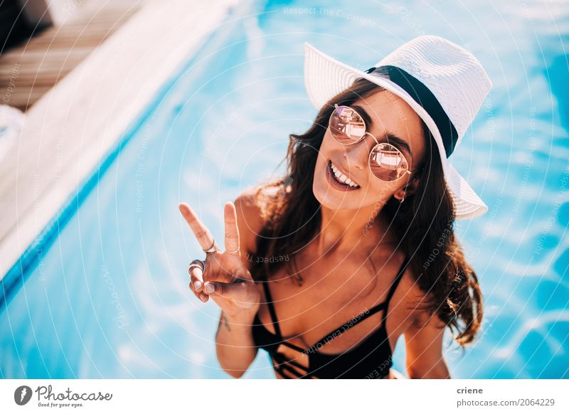 Woman making peace sign standing in swimming pool Human being Vacation & Travel Youth (Young adults) Young woman Summer Eroticism Relaxation Joy 18 - 30 years