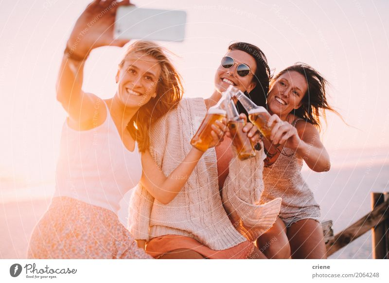 Group of young adult woman drinking beer and taking selfie Human being Vacation & Travel Youth (Young adults) Young woman Summer Sun Relaxation Joy Beach