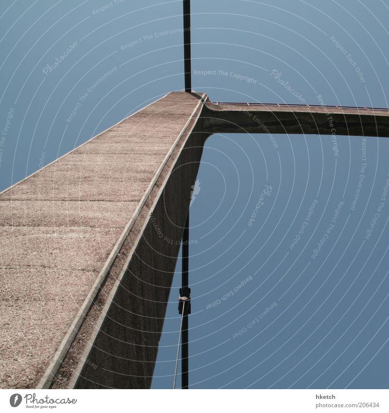 Blue Brown Concrete Bridge Steel cable Upward Column Vertical Unwavering Nature Pylon Stability Dependability Cloudless sky Bridge pier Skyward