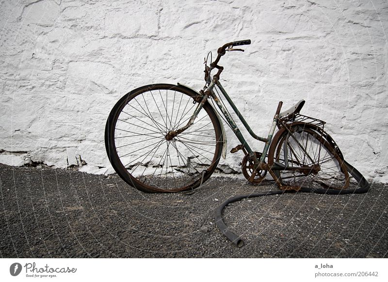 broken Bicycle Deserted Building Wall (barrier) Wall (building) Facade Lanes & trails Stone Old Stand Dirty Simple Broken Stagnating Decline Transience