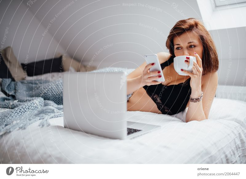 Woman browsing with smartphone and laptop in bed Human being Woman Youth (Young adults) Young woman Adults Lifestyle Feminine Leisure and hobbies Modern Fresh Technology Study Coffee Telephone Drinking Bed