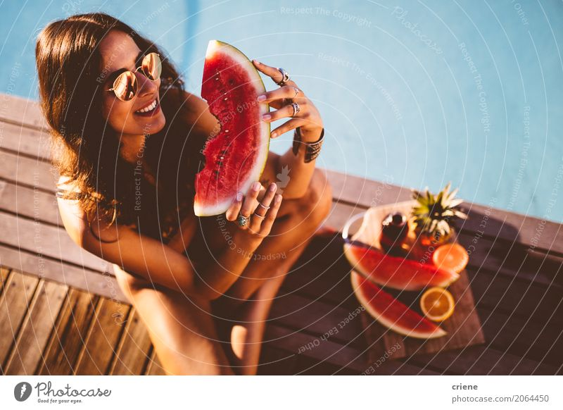 Young smiling female in swimsuit holding slice of watermelon Fruit Nutrition Eating Diet Lifestyle Healthy Eating Swimming pool Vacation & Travel Summer