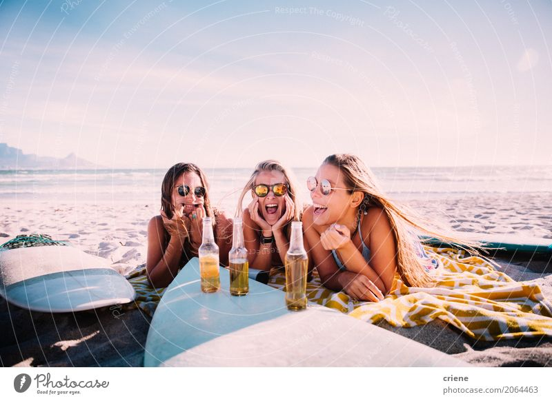 Young adult girls drinking beer at the beach and having fun Human being Woman Vacation & Travel Youth (Young adults) Young woman Summer Sun Joy Beach