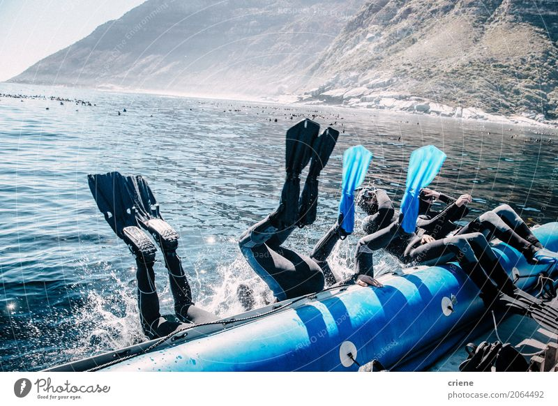 Group of friends jumping from boat for a dive Human being Vacation & Travel Summer Ocean Joy Lifestyle Sports Watercraft Friendship Jump Leisure and hobbies