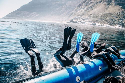 Group of friends jumping from boat for a dive Lifestyle Joy Leisure and hobbies Vacation & Travel Trip Adventure Summer Summer vacation Ocean Waves Sports Dive