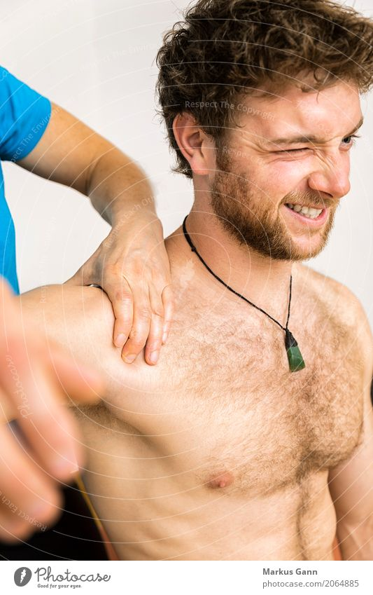 young man at the physio therapy with pain Human being Youth (Young adults) Man Hand 18 - 30 years Face Adults Body Medication Pain Doctor Chest Shoulder Massage