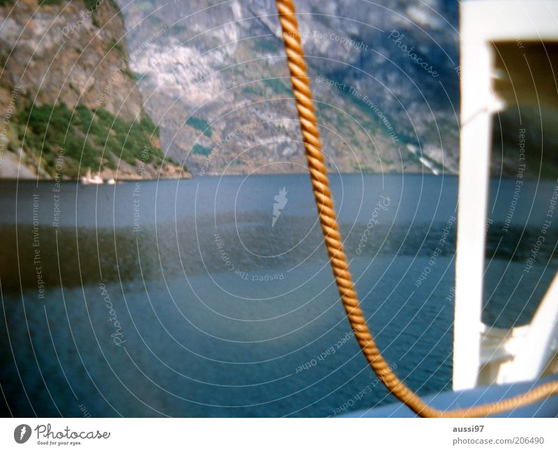 Ocean Mountain Watercraft Coast Rope Rock Sailboat Refraction Deck Surface of water Pool of light Sailing trip