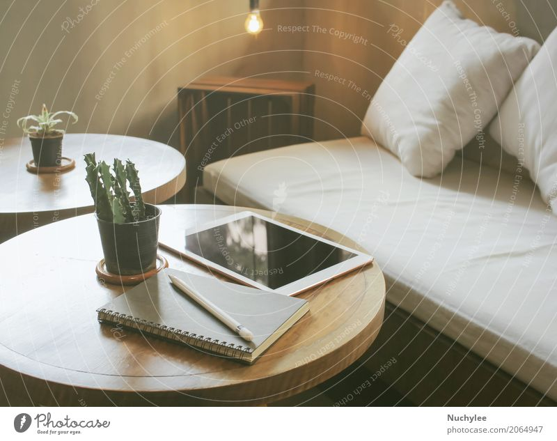 Tablet and notebook on the table in warm cozy cafe Coffee Lifestyle Shopping Relaxation Decoration Work and employment Business Screen Technology Internet Media